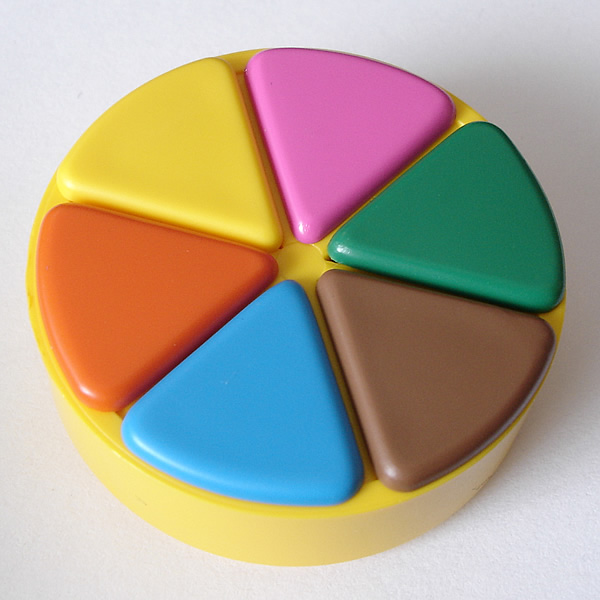 A Trivial Pursuit playing piece, with all six wedges filled